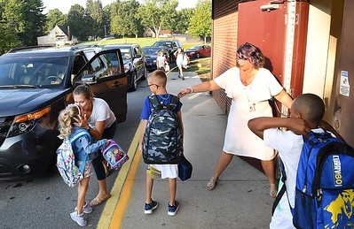 Crescent Elementary School Principal Theresa Lewis, right, directs students in the school during parent drop off for the first day of school in Raleigh County. (Rick Barbero/The Register-Herald)