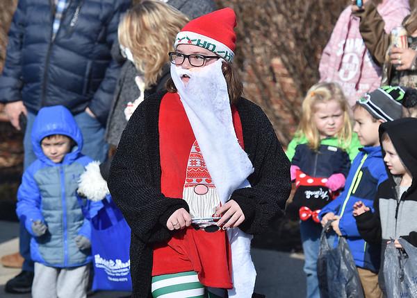 (Brad Davis/The Register-Herald) A young participant sports a Santa beard during the Beckley Christmas Parade Saturday morning.