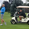 (Brad Davis/The Register-Herald) Dad Chris looks on from the cart as Nathan Daniels shoots from the fairway on 18 during BNI action Saturday afternoon at Grandview Country Club.