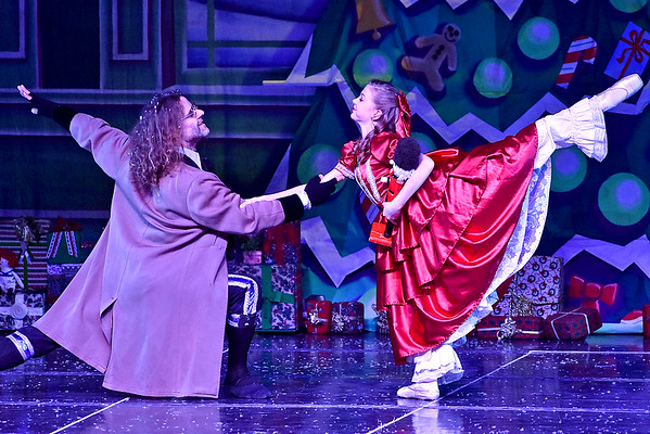 (Brad Davis/The Register-Herald) Clara, played by Louie Boyd, dances with Uncle Drosselmeyer, played by Brian Murphy, after receiving her gift during a scene from Beckley Dance Theatre and Beckley Performing Arts' presentation of The Nutcracker Sunday afternoon inside the Woodrow Wilson High School Auditorium.