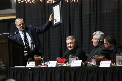 Jim Sheatsley presents Greg Darby and Cory Beasley with the Distinguished West Virginian Award during the 32nd Annual Spirit of Beckley Awards Presentation at the Beckley-Raleigh County Convention Center in Beckley on Monday. (Chris Jackson/The Register-Herald)