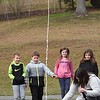 Andrea Treadway, second grade teacher at Sophia Soak Creek Elementary School, help launch a rocket that her student made from a pop bottle mixed with vinegar and baking soda.. Watching in background from left, Hunter, Lilly, Owen Moomaw, Laila Cuthbert and Kristen Bartoli.<br /> (Rick Barbero/The Register-Herald)
