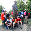 Scouts rest under a bronze statue during the 2017 National Jamboree at The Summit Bechtel Reserve near Mt. Hope. (Chris Jackson/The Register-Herald)