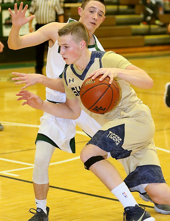 (Brad Davis/The Register-Herald) Shady Spring's Steven Williams drives to the basket as Wyoming East's Caden Lookabill defends Friday night in New Richmond.