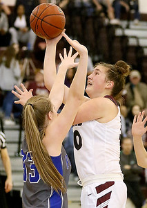 (Brad Davis/The Register-Herald) Woodrow Wilson's Laken Ball drives and scores as Princeton's Autumn Bradley defends Wednesday night in Beckley.