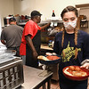 Becca Campbell, waitress at Giuseppe's Restaurant on Main Street in Mt. Hope, carries food from the kitchen.<br /> Rick Barbero/The Register-Herald)