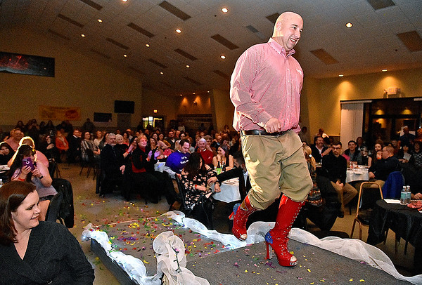 (Brad Davis/The Register-Herald) Joe Bare during the annual Hunks in Heels fundraising event for the Women's Resource Center Friday night at the Beckley Moose Lodge.