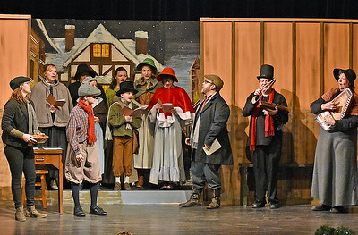 (Brad Davis/The Register-Herald) Christmas carolers sing away during a rehearsed scene Treehouse Arts Ensemble's production of A Christmas Carol, which opens tonight at Tamarack.