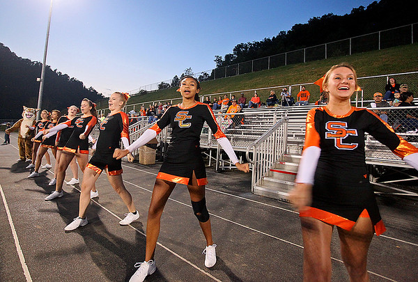 Brad Davis/The Register-Herald Summers County cheerleaders keep Bobcats fans going during a game on the road at Wyoming East Friday night.
