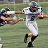 Wyoming East's Chandler Johnson gets past Nicholas County's Wes Hill during Friday's game in Summersville. Jenny Harnish/The Register-Herald