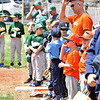 (Brad Davis/The Register-Herald) Young ball players eager to start the season wait patiently in line with their coaches as they go through the motions of opening day ceremonies Saturday afternoon at Beckley Little League Park.
