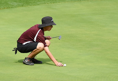 Woodrow's Jarett Childress looks to putt on the No. 18 green during a Class A Golf Tournament at the Lewisburg Elks Country Club in Lewisburg on Monday. (Chris Jackson/The Register-Herald)