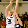 (Brad Davis/The Register-Herald) Wyoming East's Emily Saunders drives and score as Westide's Leslie Bailey defends Thursday night in New Richmond.