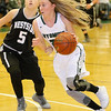 (Brad Davis/The Register-Herald) Wyoming East's Gabby Lupardus hustles around Westside's Riana Kenneda Thursday night in New Richmond.