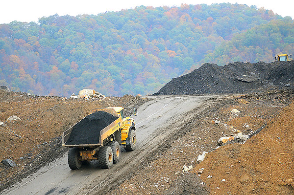 Rick Barbero/The Register-Herald Truck hauling coal away during a media tour of the Coalfields Expressway construction site.