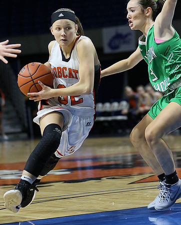 (Brad Davis/The Register-Herald) Summers County's Whittney Justice drives around Charleston Catholic's Mills Mullen during the Lady Bobcats' opening round State Tournament win over the Irish Wednesday evening at the Charleston Civic Center.