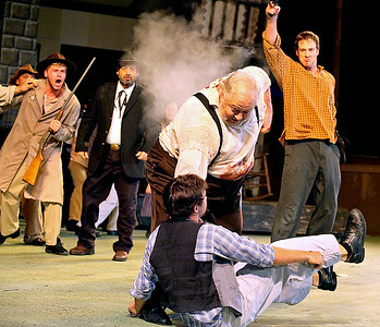 Brad Davis/The Register-Herald   Bystanders look on in horror as Tolbert McCoy (far right), played by Jason Adkins, shoots down Ellison Hatfield, played by Rick McNeely, before he can converge on Rand'l McCoy Jr. (front on ground), played by Kyle Woods, whom Hatfield knocked to the ground as he fought off a knife attack during a historic scene that transformed the families' quarrel into a bloody feud during Theatre West Virginia's Hatfields and McCoys July 25 at Grandview Park's Cliffside Amphitheatre.