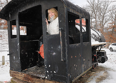 Rick Barbero/The Register-Herald Leslie Baker, director of Exhibition Coal Mine, in the back of the dinky train at New River Park.