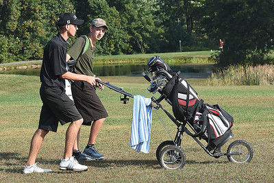 Caleb Cook, of Westside, left, walks with Brett Laxton, of Wyoming East, up the par 5, 4th fairway at Grandview Country Club during the Class AA Regional High School Golf Tournament.  (Rick Barbero/The Register-Herald)