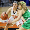 (Brad Davis/The Register-Herald) Summers County's Morgan Miller works along the perimeter as Charleston Catholic's Maddy Blaydes defends during the Lady Bobcats' opening round State Tournament win over the Irish Wednesday evening at the Charleston Civic Center.