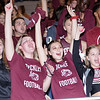 Beckley students cheer  after the Woodrow Wilson Flying Eagles make a big play. Chad Foreman for