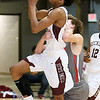 (Brad Davis/The Register-Herald) Woodrow Wilson's Mikey Penn is fouled by Cabell Midland's Hayden Cooper as he drives to the basket Wednesday night at the Beckley-Raleigh County Convention Center.