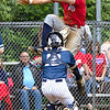 Atticus Goodson of Independence  attemps to jump over Shady Spring  catcher Parker Redden.  Goodson was out on the play, In game 2 of Sectionals Wednesday night.<br /> TINA LANEY/for The Register-Herald