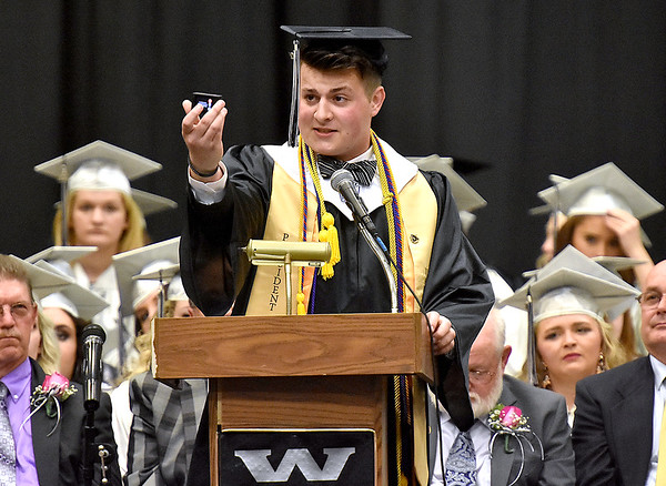 (Brad Davis/The Register-Herald) Westside Class President Jason Morgan wraps his speech with a go-pro cam during the school's 2017 Commencement Sunday afternoon in Clear Fork.