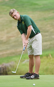 Greenbrier East's  Jacobey Gore putts on the No. 16 green during a Class A Golf Tournament at the Lewisburg Elks Country Club in Lewisburg on Monday. (Chris Jackson/The Register-Herald)