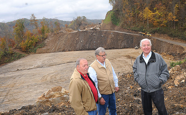 Rick Barbero/The Register-Herald Larry Mathis, Wyoming Commissioner, left, Richard Browning, executive director Coal field Expressway and Congressmen Nick Rahall,  look over the Coalfields Expressway construction site Thursday morning.