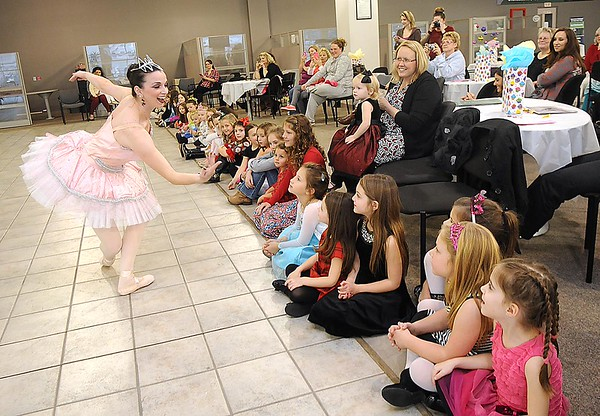 Rick Barbero/The Register-Herald Lisa West, Sugar Plum Fairy, left, entertain children and parents during the Sugar Plum Fairy Tea Party was held at Lewis Automotive Group, on 100 Appalachian Dr in Beckley Sunday afternoon. Guest enjoyed tea with Clara, the Sugar Plum Fairy and other characters from The Nutcracker. The characters also performed ballet from the show. This was a benefit event for the Heather Zickefoose Scholarship fund to aid talented students to be professional dancers.