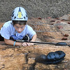 Park Middle school Student Kendyl Hayhurst, makes her way up the rock climbing wall during WVU Adventure School held at the Summit Bechtel Reserve in Glen Jean. Students were first taught the science of rock climing before adventuring up the wall.<br /> (Rick Barbero/The Register-Herald)