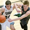 (Brad Davis/The Register-Herald) Shady Spring's Haven Chapman battle for a loose rebound with Wyoming East's Anthony Martin on Big Atlantic Classic Championship Saturday at the Beckley-Raleigh County Convention Center.