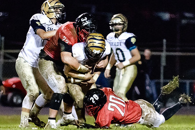 Shady Spring's attempt at an end around reverse gets stuffed in the backfield by Oak Hill defenders Logan Lawhorn (33) and Antwan Pagan (20). Chad Foreman for the Register-Herald.