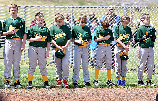 (Brad Davis/The Register-Herald) Young ball players eager to start the season wait patiently in line as they go through the motions of opening day ceremonies Saturday afternoon at Beckley Little League Park.