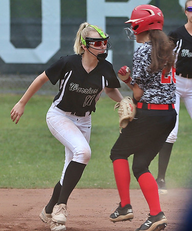 Wyoming East's Kayley Bane tags a runner on second to complete a double play in the third inning.