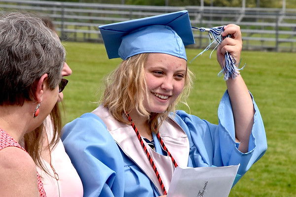 Erin Thomas is all smiles after graduating from Meadow Bridge High School on Saturday.<br /> Steve Keenan/The Register-Herald