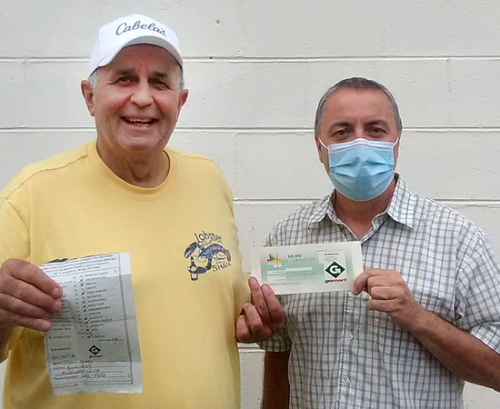 Gary Stafford, circulation manager Beckley Newspapers, right, presents Week 3 Pigskin Pick'em winner Tim Jeffrey with a $50 GoMart girt certificate.