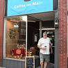 Tom Halsey, of Hotchkiss, exits Coffee On Main on Main Street in Beckley.<br /> (Rick Barbero/The Register-Herald)