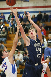 (Brad Davis/The Register-Herald) Greenbrier West's Collin O'Dell turns and scores as Midland Trail's Liam Gill defends Friday night in Hico.