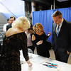 Guests register for their tables during the 98th annual Beckley-Raleigh County Chamber of Commerce Annual Dinner at the convention center in Beckley Friday.(Chris Jackson/The Register-Herald)