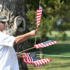 Ron Knapp placing American flags during the practice round for, A Military Tribute at The Greenbrier, held on The Old White TPC course at The Greenbrier Resort in White Sulphur Springs.<br /> (Rick Barbero/The Register-Herald)