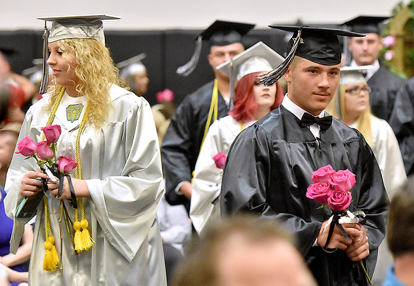 (Brad Davis/The Register-Herald) Graduating Westside seniors seek out family members during the flower ceremony prior to the school's 2017 Commencement Sunday afternoon in Clear Fork.