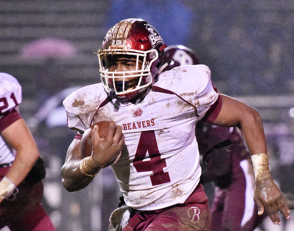 Bluefield's Arnold Martin (4) carries on a long run during their football game against Woodrow Wilson Friday in Beckley. (Chris Jackson/The Register-Herald)