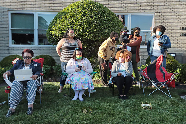 Supporters of a local ordinance that will protect against discrimination based on the hair texture of a race or ethnic minority gather on the lawn in front of City Hall for a viewing of the Council meeting Tuesday.  Jenny Harnish for the Register-Herald