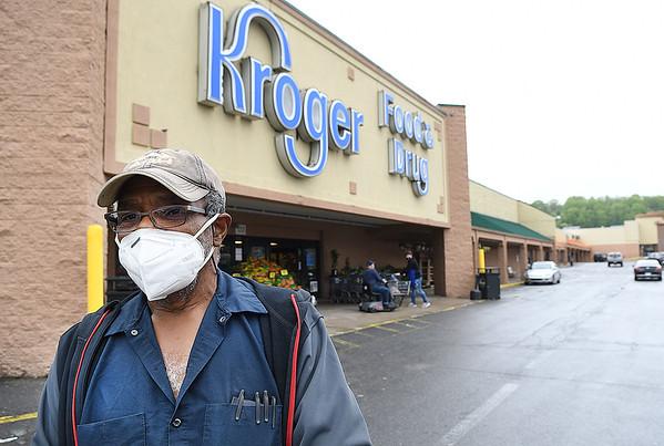 Thomas Jones, of Beckley, exits Krogers at Beckley Crossing Shopping Plaza Monday evening.<br /> (Rick Barbero/The Register-Herald)