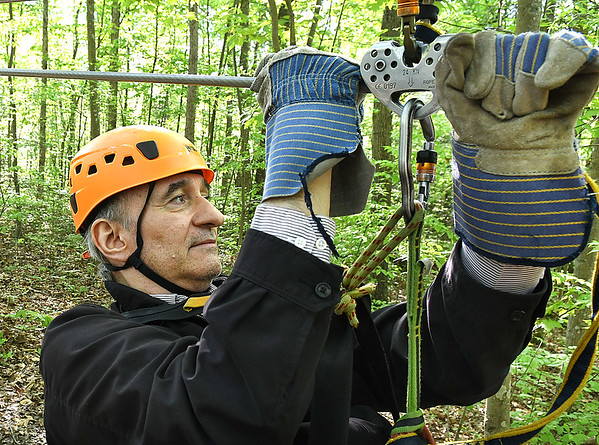 Richard Varr, from Houston, member of the Freelance Council of the Society of American Travel Writers, zipping during the TreeTops Zipline Canopy Tours at Adventure On The Gorge Wednesday morning. Forty-one Travel Writers are exploring and writing about West Virginia this week.<br /> (Rick Barbero/The Register-Herald)