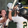 Greenbrier East's Annabelle Honaker celebrates with Lindsey Black during the Class AAA Region 3 softball game against St. Albans in Fairlea Monday.  Jenny Harnish for the Register-Herald
