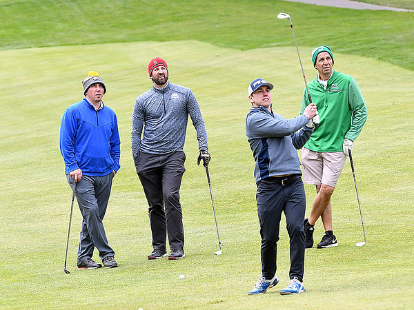 Nick Cyr, Anheuser Bush, chips up on the par 4, 4th hole on the Cobb Course at Glade Springs Resort, during the Jan Vineyard Children's Charity Golf Outing. Watching from left, Matt Arcure, Valley Distributing, Joe Scholl, Anheuser Bush, and Mark George, Anheuser Bush.<br /> (Rick Barbero/The Register-Herald)