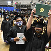 Rachel White, of Bekley, holds up her diploma after graduating from New River Community & Technical College at the Beckley-Raleigh County Convention Center Saturday morning.<br /> (Rick Barbero/The Register-Herlad)